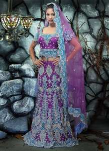 Purple Applique Net Lehenga Choli. Photo courtesy of Cbazaar.